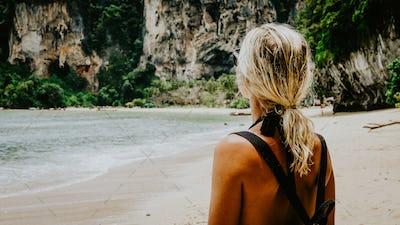 Blond beautiful Women with Sunglasses and Backpack on Raily, Hat Tom Sai Beach, Railay, Krabi