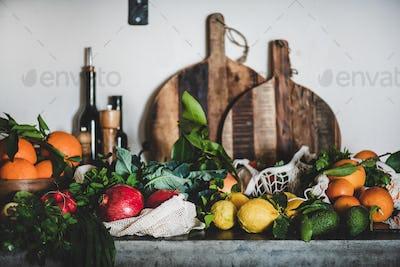 Assortment of vegan, vegetarian, balanced diet foods on kitchen counter