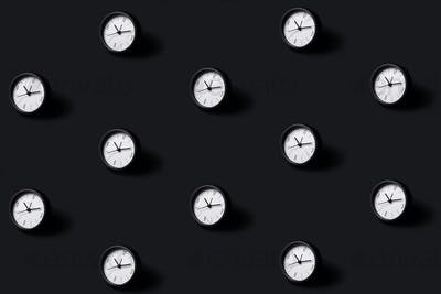 Pattern Made of Black Clocks on Black Background.