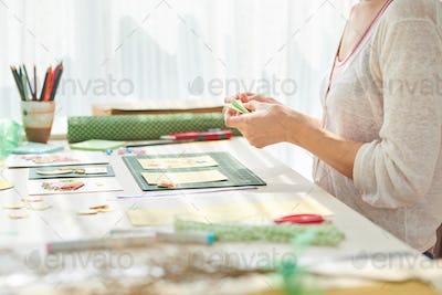 Woman Scrapbooking at Home