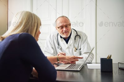 Female patient consulting with medic at computer