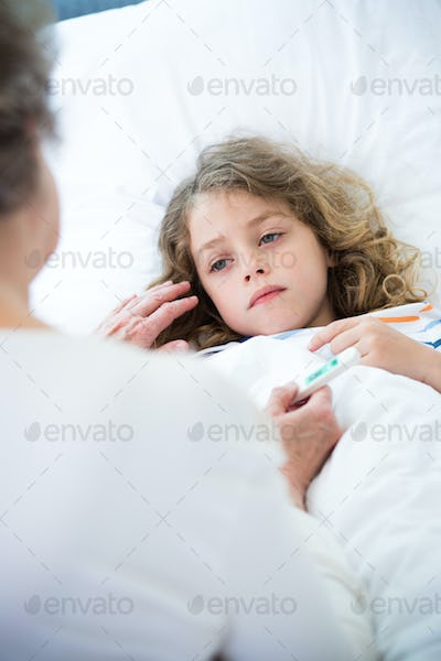 Grandmother taking care of her sick small grandson