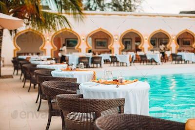 Summer empty open air luxury restaraunt at exotic hotel