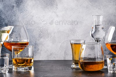 Set of strong alcoholic drinks in glasses in assortment