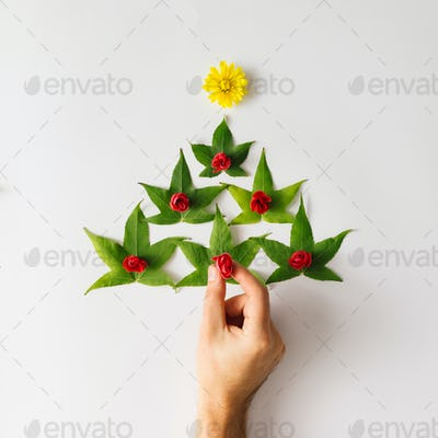 Christmas tree made of leaves and flowers