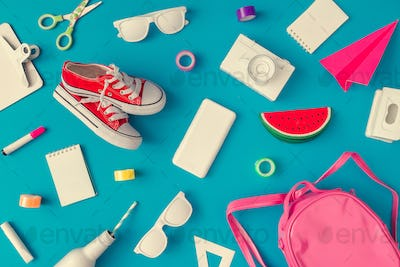 Creative layout of school supplies against pastel blue background. Minimal back to school concept.