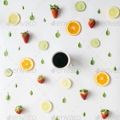 Colorful  coffee pattern made of citrus fruits and strawberries. Flat lay