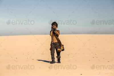 Post Apocalyptic Warrior Boy Outdoors in Desert Wasteland