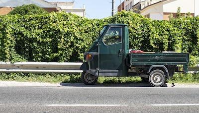 Typical italian farm ape truck on three wheels.