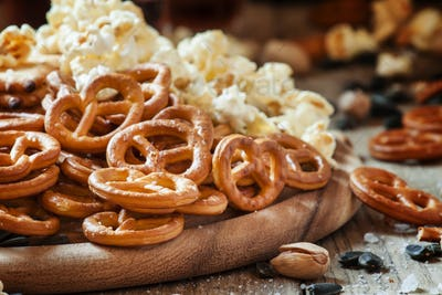 Salted straws in the shape of pretzels, popcorn and other salty snacks