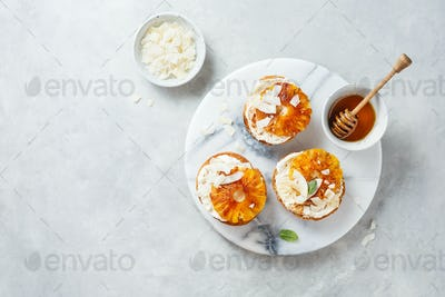 Delicious toast with cream cheese, roasted pineapples, cinnamon and coconut