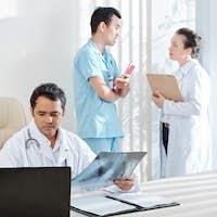 Pulmonologist examining lungs x-ray