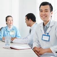 Intern attending meeting in hospital