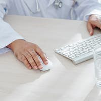 General practitioner working on computer