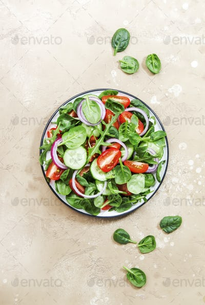 Spring vegan salad with spinach