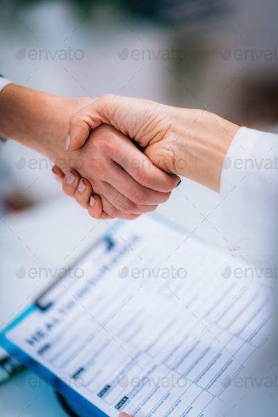 Handshake After Signing Health Insurance Form