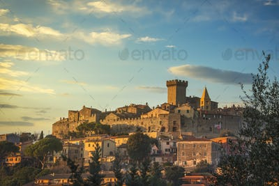 Capalbio medieval village skyline at sunset. Maremma, Tuscany Italy