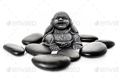 happy buddha statue with massage stone isolated on white