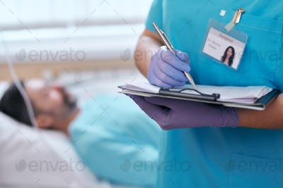 Filling patients card in hospital