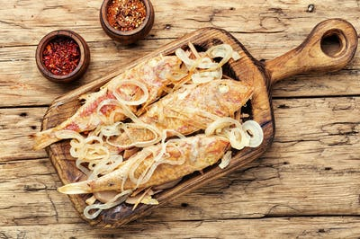 Fried fish with horseradish roots