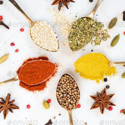 Set of spices in spoons top view. Paprika, curry, Bay leaf, anise and other seasonings