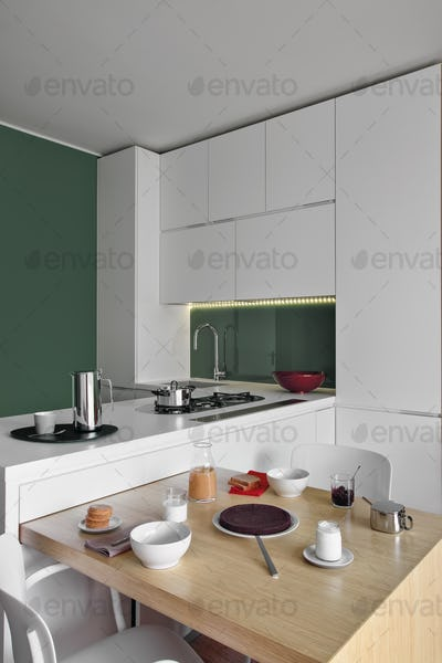 Interiors of the Kitchen and the Bathroom in a Modern Apartment