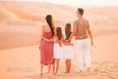 People among dunes in Rub al-Khali desert in United Arab Emirates