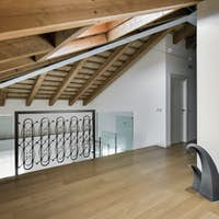 Interiors of a Modern Living Room in the Attic With Wood Floor