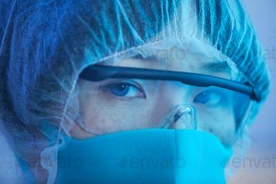 Female Laboratory Scientist Looking At Camera