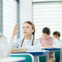 Girl Asking Question To Teacher