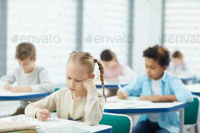 Bored Blond Girl In Class