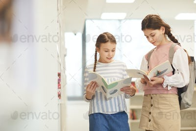Two Girls With Notebooks