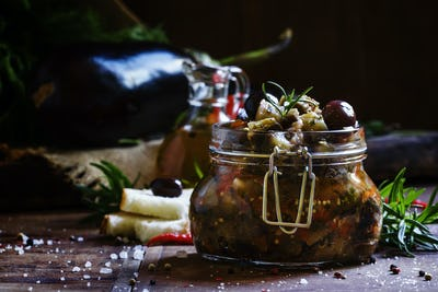 Stewed eggplant with peppers, tomatoes and olives