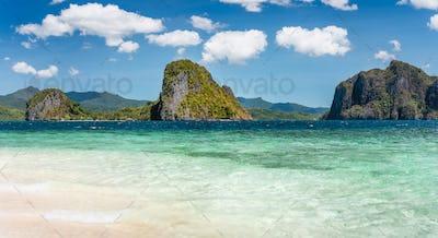 El Nido, Philippines. Panorama of limestone islands in El Nido Lagoon. Private Malapacao island in