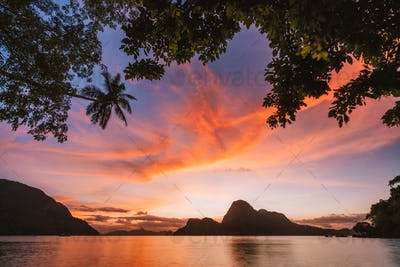 Sunset with silhouette of a tropical island. El Nido bay. Philippines