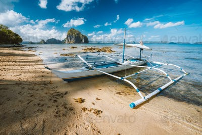 Tourist banca boat in morning light ready for island hopping trip. Nature scene of El Nido area