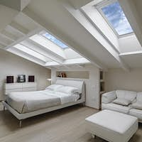 Interiors of the Modern Bedroom in the Mansard