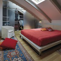 Interiors of a Modern Bedroom in the Attic