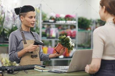 Flower Saleswoman Talking to Customer