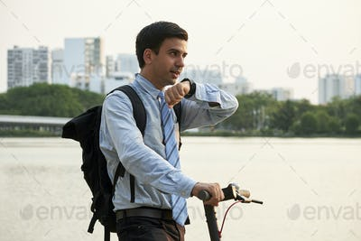 Businessman setting destination point via smart watch