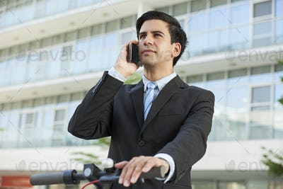 Ambitious businessman calling on phone