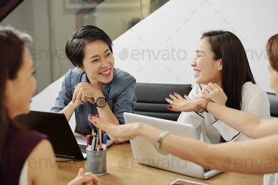 Cheerful talking businesswomen