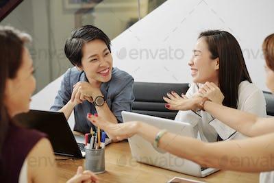 Cheerful talking businesswomen