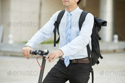 Young businessman with big backpack