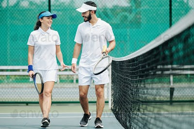 Couple discussing tennis game