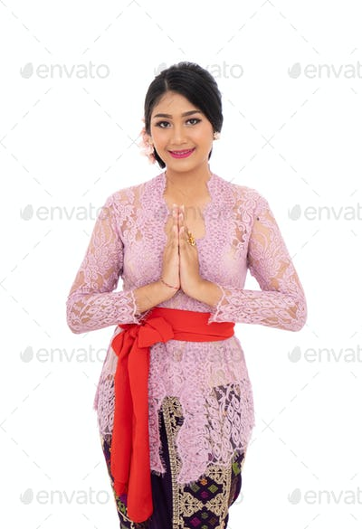 Balinese woman with gestures welcoming