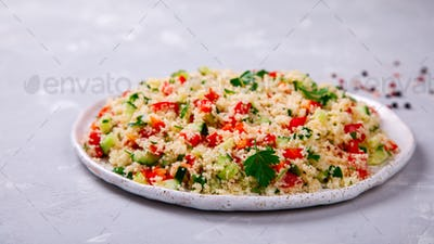 Tabbouleh salad with couscous on the plate.Traditional middle eastern