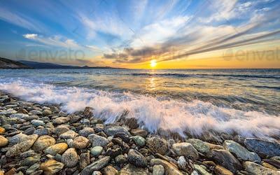 Waves breaking on pebble beach