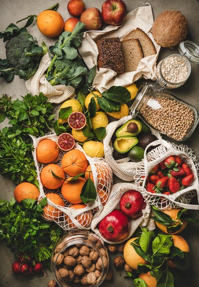 Assortment of vegan, vegetarian, balanced diet foods over concrete background