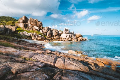 Remote beach Grand L Anse, La Digue, Seychelles. Tropical ocean coast, unique granite rocks and